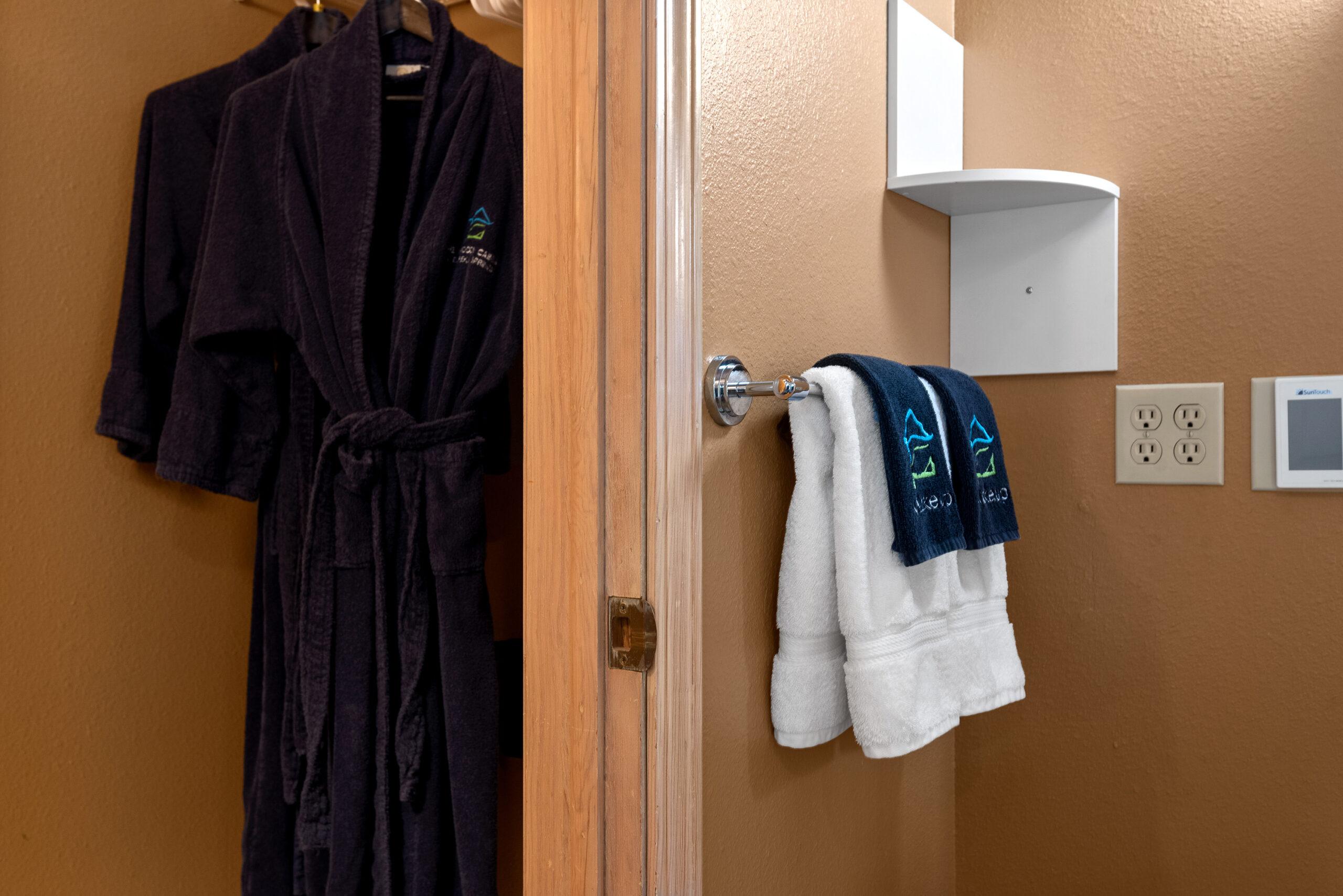 Monogramed bathrobes and makeup towels